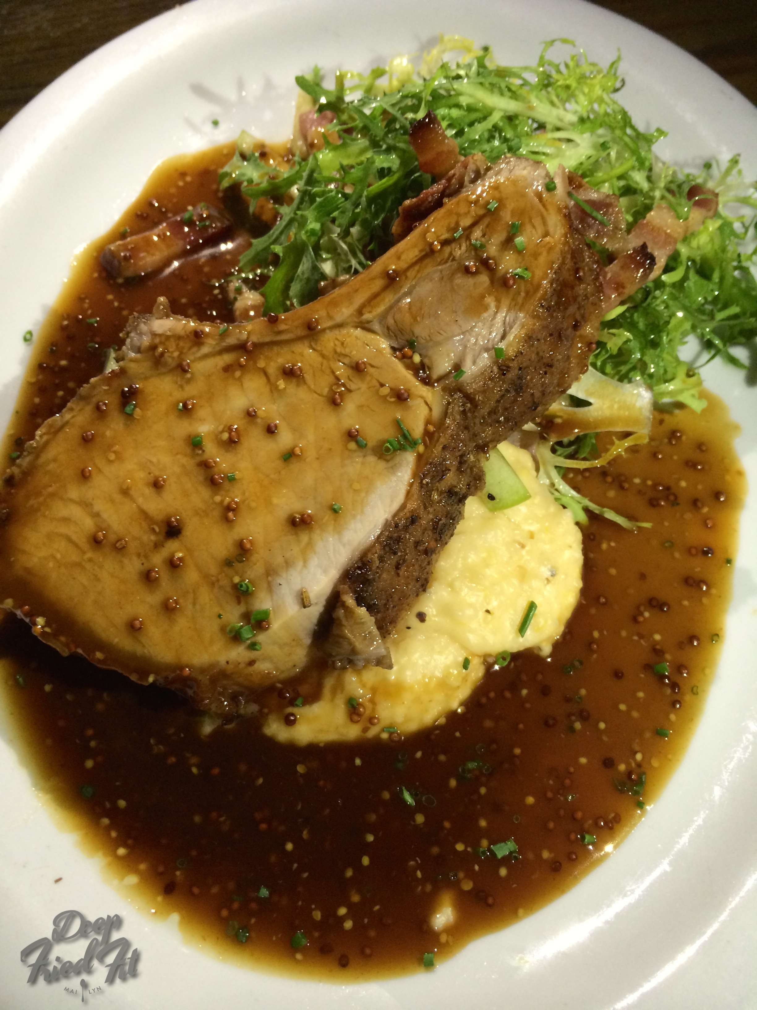 Roasted Duroc Pork Rack over corn grits, apple frisee salad.